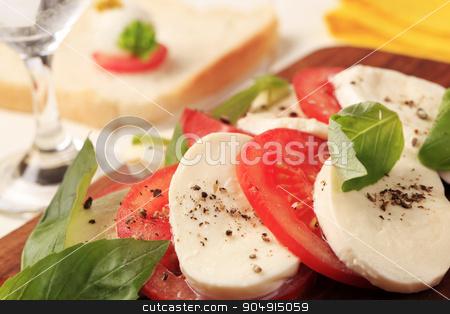Caprese salad stock photo, Slices of fresh mozzarella cheese and tomato by Digifoodstock