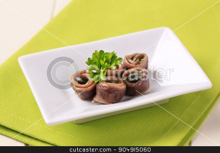 Rolled anchovies with capers stock photo, Rolled Fillets of Anchovies with Capers by Digifoodstock