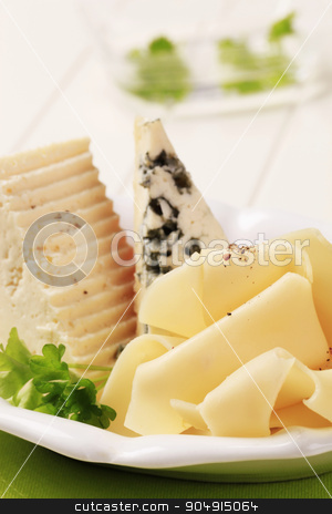 Selection of cheeses stock photo, Three different types of cheese on a plate by Digifoodstock