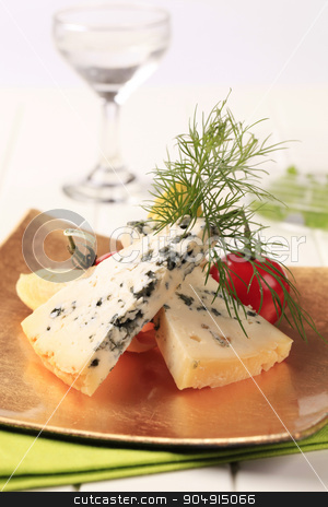 Appetizer stock photo, Blue cheese and fresh vegetables garnished with dill by Digifoodstock