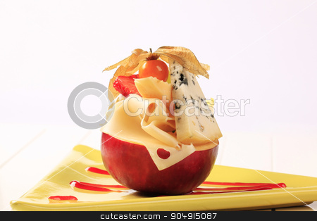 Cheese appetizer stock photo, Pieces of cheese on a red apple by Digifoodstock