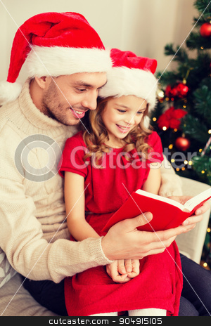 smiling father and daughter reading book stock photo, family, christmas, x-mas, winter, happiness and people concept - smiling father and daughter in santa helper hats reading book by Syda Productions
