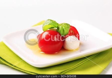 Baby mozzarella and tomatoes stock photo, Baby mozzarella cheese balls, tomatoes and basil by Digifoodstock