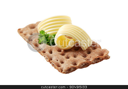 Crisp bread and butter stock photo, Brown crisp bread and butter - cutout by Digifoodstock