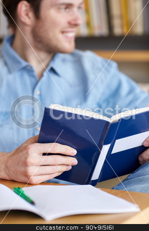 close up of student reading book at school stock photo, people, knowledge, education and school concept - close up of student reading book at school library by Syda Productions