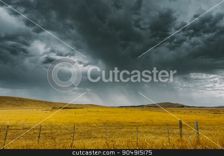 Storm brewing stock photo, A storm is brewing over crops after a sever heatwave in Melbourne. by David Hewison