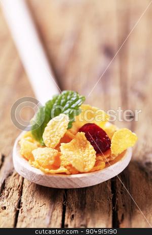 Corn flakes on wooden spoon stock photo, Corn flakes on wooden spoon - closeup by Digifoodstock