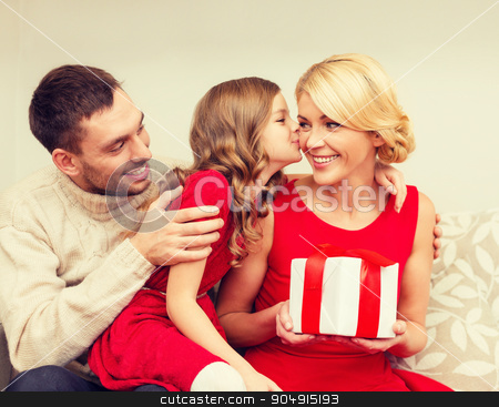 adorable child kisses her mother stock photo, family, christmas, x-mas, happiness and people concept - adorable child kisses her mother and gives present by Syda Productions