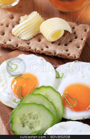 Breakfast stock photo, Breakfast - Fried eggs, crisp bread and butter by Digifoodstock