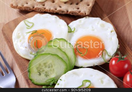 Breakfast stock photo, Breakfast - Fried eggs, crisp bread and fresh vegetables by Digifoodstock