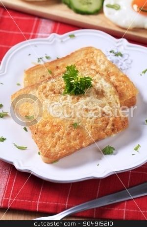 French toast stock photo, Two pieces of French toast on plate by Digifoodstock