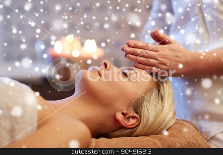 close up of woman having face massage in spa salon stock photo, people, beauty, spa, winter and relaxation concept - close up of beautiful young woman lying with closed eyes and having face or head massage in spa with snow effect by Syda Productions