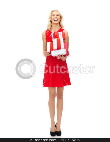 happy young woman in red dress holding gift boxes stock photo, people, christmas, birthday and holidays concept - happy young woman in red dress holding gift boxes by Syda Productions