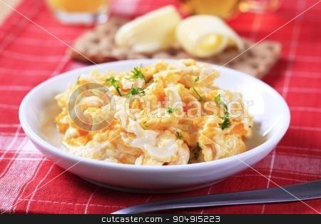 Scrambled eggs stock photo, Breakfast of scrambled eggs, crispbread and butter by Digifoodstock