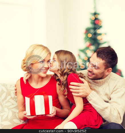 adorable child kisses her mother stock photo, family, christmas, x-mas, winter, happiness and people concept - adorable child kisses her mother and gives present by Syda Productions