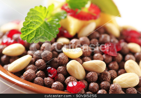 Chocolate puffs with almonds and dried cranberries stock photo, Cocoa-flavored puffed grain breakfast cereal with almonds and dried cranberries by Digifoodstock