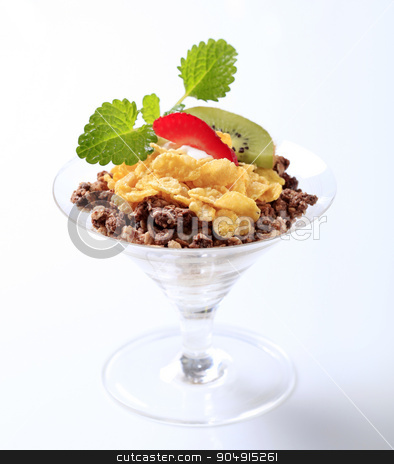 Breakfast cereal stock photo, Chocolate granola and corn flakes topped with fruit by Digifoodstock
