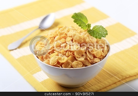 Corn flakes  stock photo, Bowl of crunchy corn flakes - closeup by Digifoodstock