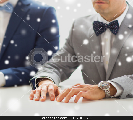 close up of happy male gay couple hands on wedding stock photo, people, homosexuality, same-sex marriage and love concept - close up of happy male gay couple hands on wedding over snow effect by Syda Productions