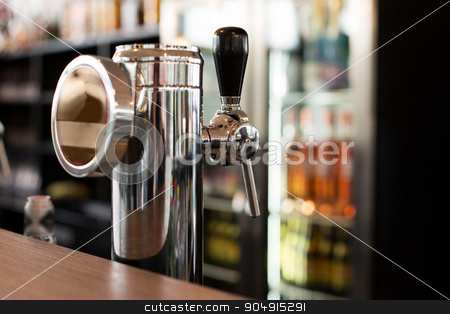 close up of single tap chrome draft beer tower stock photo, drink, equipment and object concept - close up of single tap chrome draft beer kegerator tower at bar or pub by Syda Productions