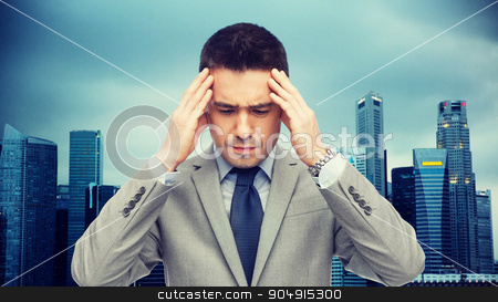 businessman in suit having head ache stock photo, business, people, crisis and fail concept - businessman in suit having head ache over city background by Syda Productions