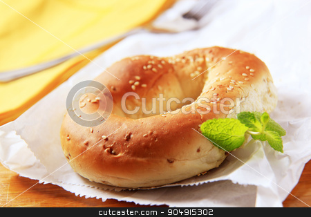Bagel stock photo, Fresh bagel with sesame seeds on top by Digifoodstock
