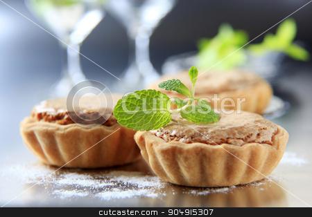 Mini tarts stock photo, Small shortbread tart shells with nut filling  by Digifoodstock