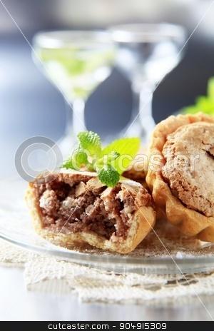 Mini almond tarts stock photo, Small shortbread tart shells with nut filling by Digifoodstock