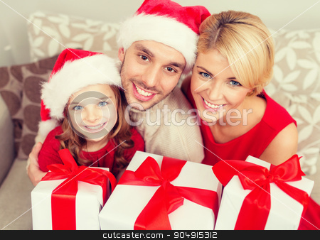 smiling family holding many gift boxes stock photo, family, christmas, x-mas, happiness and people concept - smiling family in santa helper hats with many gift boxes by Syda Productions