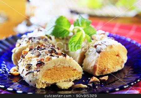 Marzipan crescent cookie stock photo, Marzipan crescent cookie sprinkled with chopped almonds by Digifoodstock