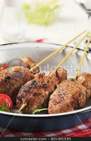 Minced meat kebabs  stock photo, Minced meat kebabs and mushrooms in a pan by Digifoodstock