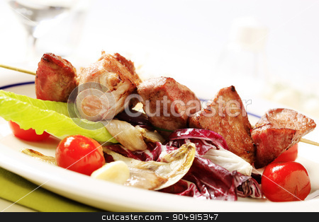 Pork skewer with vegetables stock photo, Pork shish kebab and vegetable accompaniment by Digifoodstock