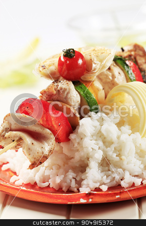 Chicken shish kebab and rice stock photo, Chicken shish kebab on bed of white rice by Digifoodstock