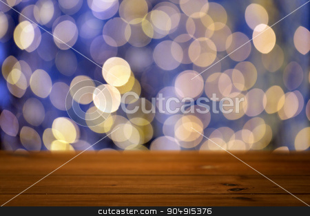 empty wooden table with christmas golden lights stock photo, holidays, new year and celebration concept - close up of empty wooden surface or table over christmas golden and blue lights background by Syda Productions