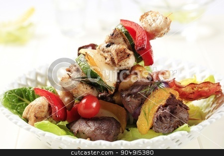 Grilled shish kebabs stock photo, Grilled shish kebabs on lettuce leaves by Digifoodstock