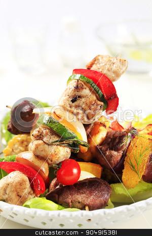 Shish kebabs stock photo, Various types of shish kebabs on lettuce leaves by Digifoodstock