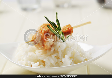 Chicken skewer and rice stock photo, Chicken skewer on bed of white rice by Digifoodstock