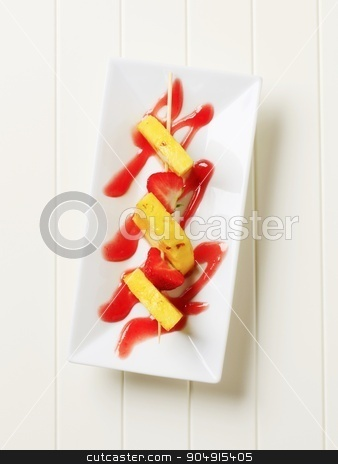 Fruit skewer stock photo, Pineapple and strawberry skewer with sweet sauce by Digifoodstock