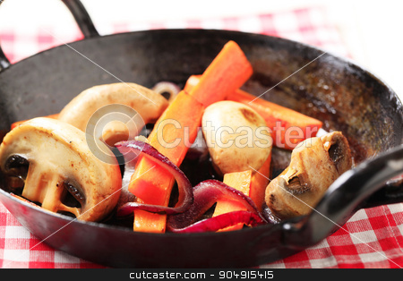 Pan seared vegetables stock photo, Pan seared  mushrooms, and strips of carrot by Digifoodstock