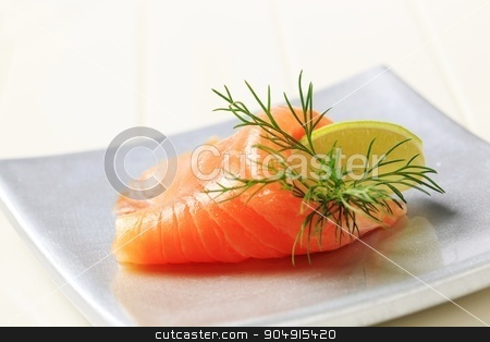 Smoked salmon stock photo, Thin slice of smoked salmon and lime by Digifoodstock