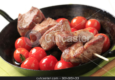 Pork kebab and tomatoes stock photo, Pork kebab and cherry tomatoes in a pan by Digifoodstock
