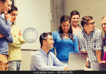 group of students and teacher with laptop stock photo, education, high school, technology and people concept - group of smiling students and teacher with papers, laptop computer in classroom by Syda Productions