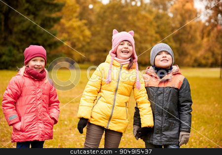 group of happy children in autumn park stock photo, childhood, leisure, friendship and people concept - group of happy children in autumn park by Syda Productions