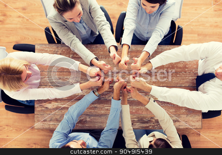business team showing thumbs up stock photo, business, people and team work concept - close up of creative team showing thumbs up and sitting at table in office by Syda Productions