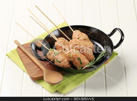 Minced meat kebabs stock photo, Raw minced meat kebabs on wooden skewers by Digifoodstock