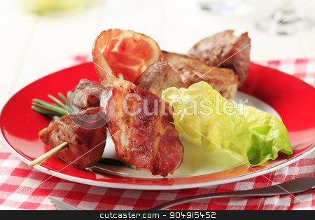 Pork kebab stock photo, Pork shish kebab and rasher of bacon by Digifoodstock