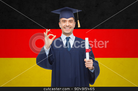smiling adult student in mortarboard with diploma stock photo, education, graduation, gesture and people concept - smiling adult student in mortarboard with diploma showing ok hand sign over german flag background by Syda Productions