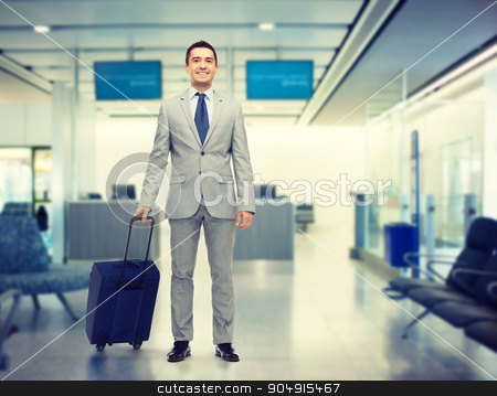 happy businessman in suit with travel bag stock photo, business trip, traveling, luggage and people concept - happy businessman in suit with travel bag over airport background by Syda Productions