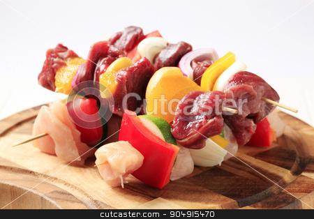 Raw shish kebabs stock photo, Raw shish kebabs on a cutting board by Digifoodstock