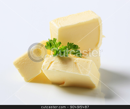 Fresh butter stock photo, Blocks of fresh butter and parsley - studio by Digifoodstock